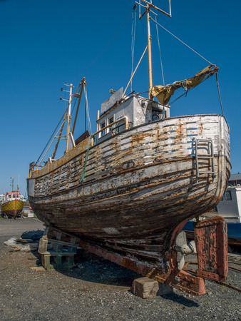 unkempt: Old unkempt boat in Reykjavik, Iceland. Stock Photo