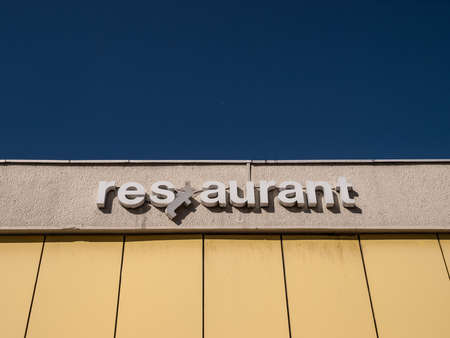 sarajevo: Broken restaurant sign at Holiday Inn, Sarajevo, Bosnia and Herzegovina, Europe. Editorial