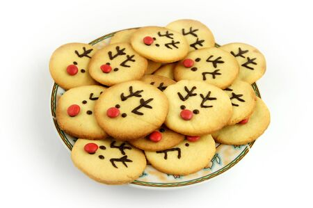 Christmas reindeer cookies on plate isolated on white photo