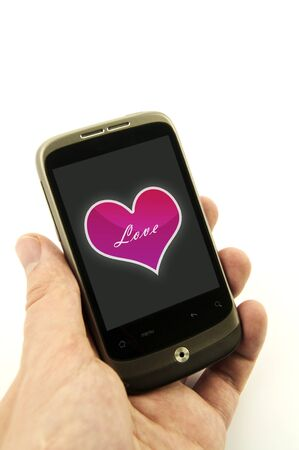 Hand holding phone with valentine heart. Pink heart with love message Stock Photo - 11879107