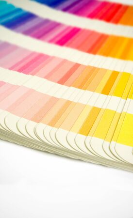 Pantone swatches book open showing an array of rainbow colours