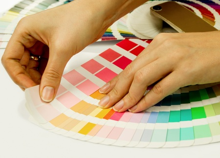 tied down: Woman selecting color from Pantone swatches book