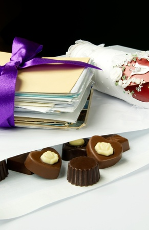 Sweet valentine mail. Chocolate composition with bow and letters photo