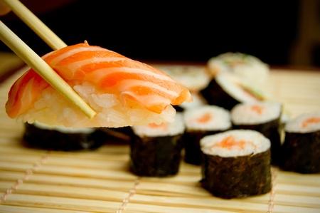 Japanese sushi set. Tuna, sticks on bamboo napkin Stock Photo - 12239432