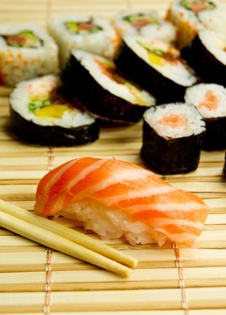 nigiri: Japanese sushi set. Tuna, sticks on bamboo napkin