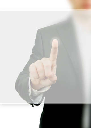 Business man in a suit pointing screen with his finger Stock Photo
