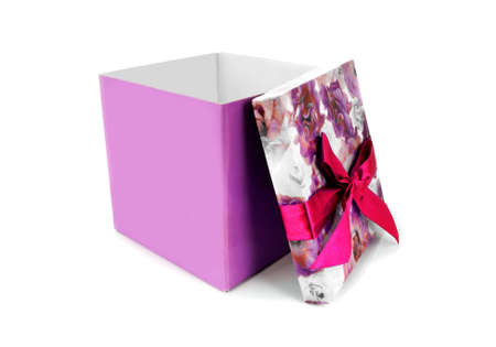 Opened gift box with bow over white background photo