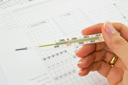 sexual intercourse: Traditional thermometer, graphs and fertility chart Stock Photo