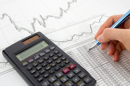 Calculator and pen on a business background  photo