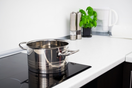 Pot in modern kitchen with induction stove photo