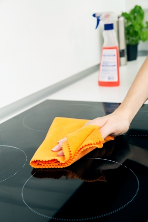 Hand cleaning induction stove photo