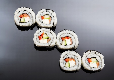 Sushi set on black reflection background photo