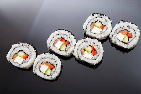 japenese: Sushi set on black reflection background