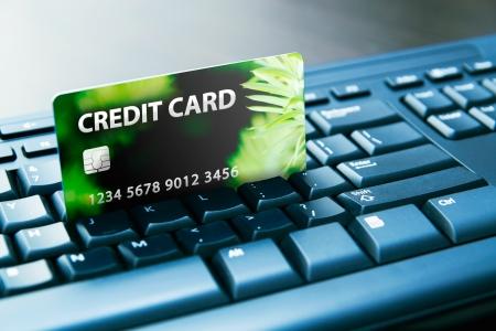 mastercard: Colorful credit card on computer keyboard Stock Photo