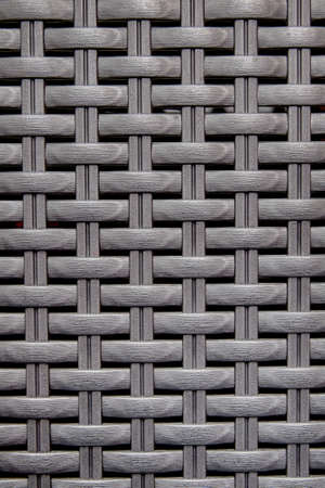 Black wooden striped textured basket weaving background.  photo