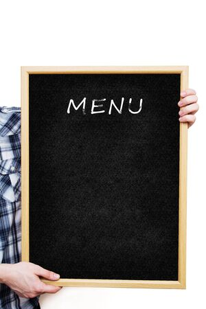 Man holding a blank black board, showing an empty menu  photo