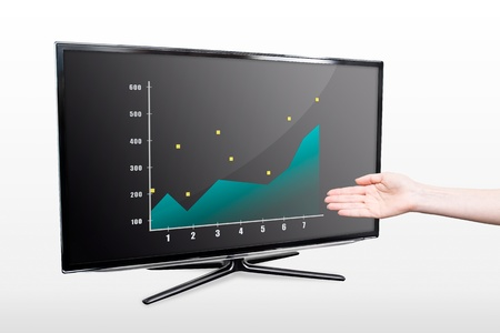 Business success growth chart  Hand showing modern TV screen photo