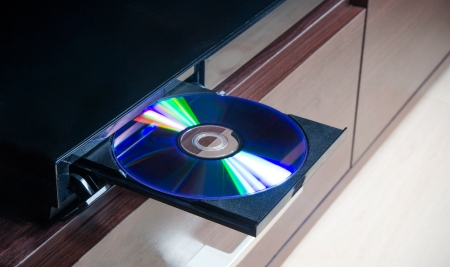 blu: Disc insterted to DVD or CD player Stock Photo