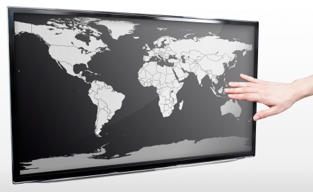 Hand showing blank world map on LED TV screen photo