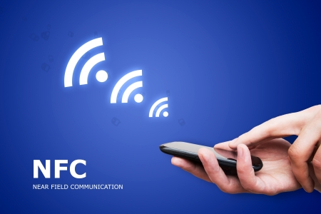 contactless: Hand holding smartphone with NFC technology - near field communication payment method Stock Photo