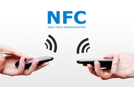 rfid: Two mobile phones with NFC payment technology. Near field communication