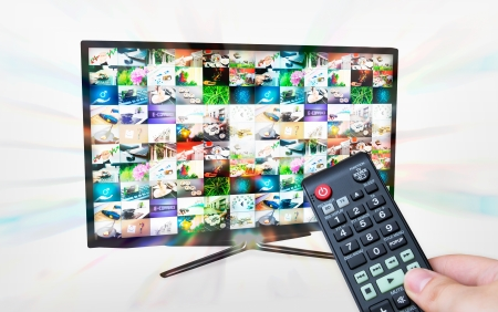 TV with multiple images gallery. Streaming glow effect. Hand hold remote control photo