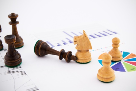 chellange: Chess pieces on business background. Company strategic behavior Stock Photo