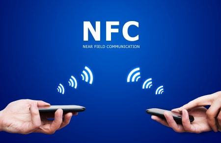 nfc: Hand holding smartphone with NFC technology - near field communication payment method Stock Photo