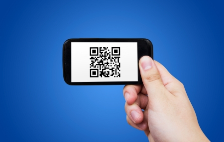 Smartphone scanning QR code Stock Photo - 20407376