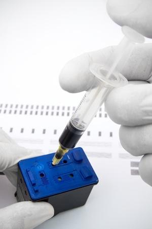 consumable: Cartridge refuelling with the syringe  Stock Photo