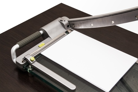 guillotine: Sheet of paper in the guillotine