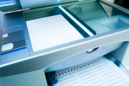 office printer: Close-up working printer scanner copier device