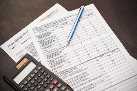 Polish tax form with pen and calculator on desk photo