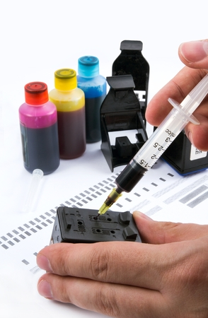 refill: Injecting ink cartridge. Set of refill inkjet for print. Stock Photo
