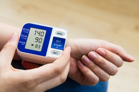 blood pressure gauge: High blood pressure. woman measures the pressure
