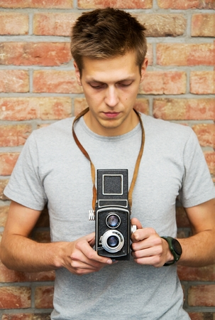 Man with old camera photo