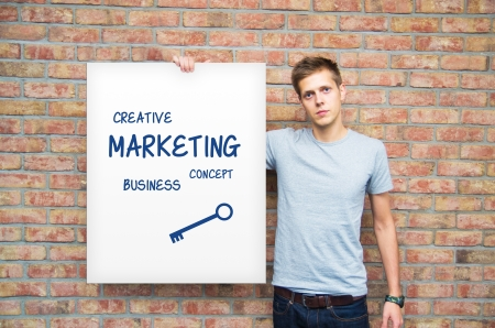 backlink: Young man holding whiteboard with marketing content. Business presentation.
