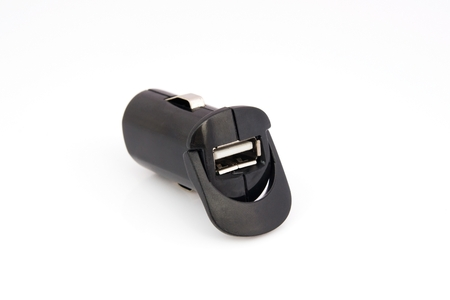 USB car charger isolated on white photo