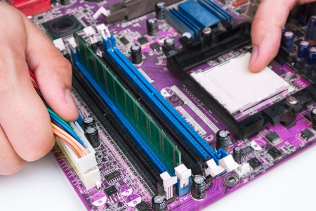 computer repair: Technician repairing computer hardware