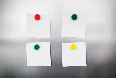 inox: White reminders with magnets on fridge