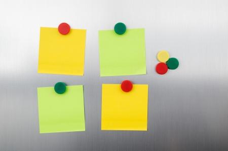 inox: Coloured notes and magnets on inox metallic fridge