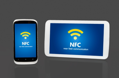 Mobile devices with NFC chip. Wireless communication and payment method photo