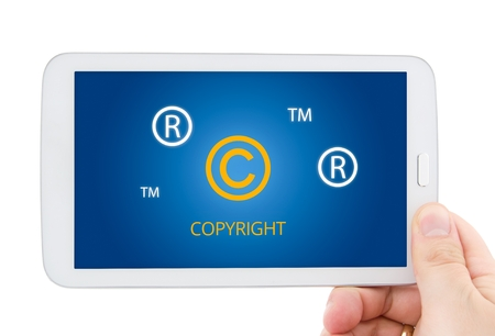 Copyright, registered, trademark symbols on tablet pc display photo