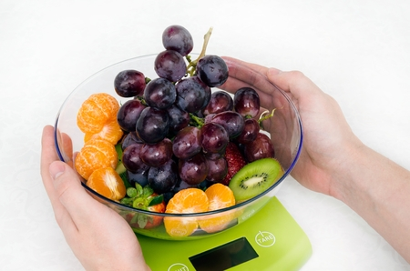 kitchen scale: Lots of fruit on the kitchen scale in a modern kitchen
