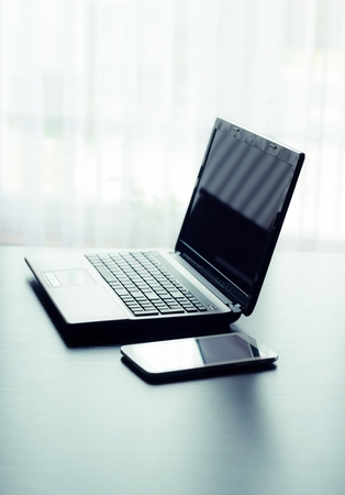 Modern laptop and tablet in office photo