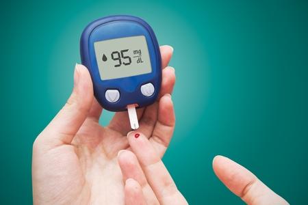 blood glucose: Woman doing blood sugar test