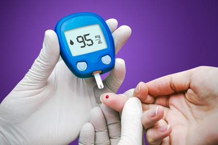 blood sugar: Doctor making blood sugar test. Hands with gloves on medical background