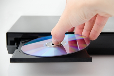 Disc insterted to DVD or CD player Stock Photo