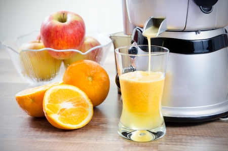 Juicer and orange juice