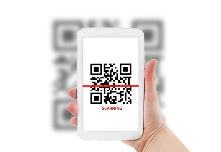 laser tag: Tablet scanning QR code Stock Photo